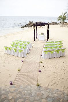 Really cool net aisle runner for a beach wedding.