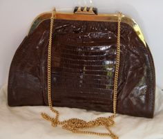 Bruno Magli - Vintage alligator & Tortoise Shell Clutch You can find this item and more on www.handbagconsignmentshop.com