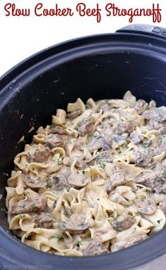 Slow Cooker Beef Stroganoff - tender beef tips, onions, mushrooms, all in a creamy sauce. Serve over egg noodles for an easy family favorite meal. Make it in your Crock-Pot!