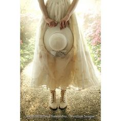 Trevillion Images - vintage-woman-standing-with-hat