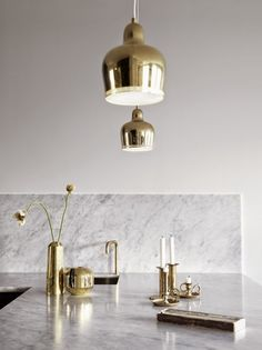 Read our definitive guide to marble and brass home decor. See and shop classy, chic and trendy marble and brass furniture and home accessories for your living room, dining room, kitchen and bathroom. For more design trends go to Domino. Decor, Kitchen Peninsula, Contemporary Kitchen, Brass Decor, Gold Kitchen, Gold Interior, Decor Guide, Kitchen Styling, Luxury Interior Design