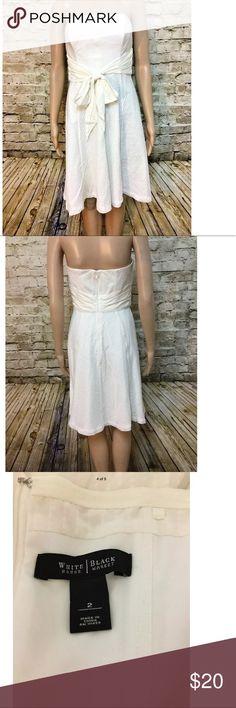 "Fabulous white silk strapless dress with bow Fabulous white silk strapless dress with bow Back zipper and circle skirt Size: 2 Chest: 34"" Waist: 27"" Length: 31"" White House Black Market Dresses Midi"