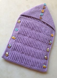Free Knitting Pattern for Fisherman's Baby Envelope - This cocoon is knit in fishermen's rib as one rectangular piece then folded like an envelope and buttoned on the sides. Designed by Amal Saleh.