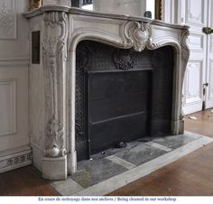 antique Louis XV style fireplace made out of Carrara marble with cast iron insert
