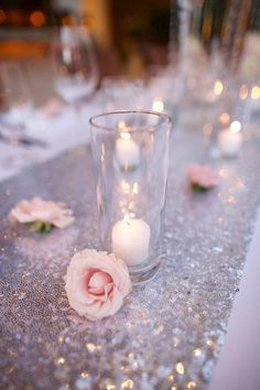 Silver sequined wedding table runner, little pink roses and candles