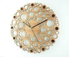 This wall clock is called Circle Union. The design comprises of a random pattern of circles of various sizes joined in union to form a unique timepiece that looks great in any modern home.  Chapter markers are laser etched around the outside of the clock face.  The clock face is laser cut from eco friendly solid bamboo. Outside diameter of face at 280 mm (11) and protrudes 25 mm (1) from the wall.  The clock mechanism is a quartz sweep type which means its virtually silent (no ticking) and…