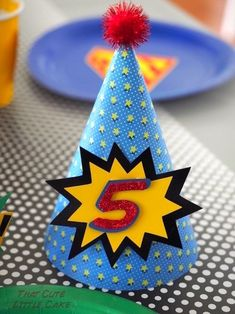 Party hat from Lego Superhero Birthday Party at Kara's Party Ideas. See more at karaspartyideas.com!