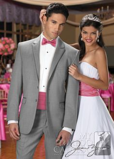 The Heather Grey 'Savoy' Tuxedo by Jean Yves is an eye-catching formal crowd-pleaser. Featuring a 2 button single breasted front, self notch lapel and top collar with satin trim, self flap pockets with satin trim, and fashioned from an incredible grey Super 100's wool, this modern fittuxedo will help you look your very best for any any prom, wedding, destination wedding, or other formal event you plan on gracing.
