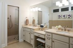 Master suite bathroom with dual vanities, make up vanity, Crema Marfil marble countertops and spa shower.  Designed and renovated by Ramage Company.