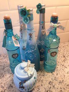 Geverfde flessen blauw tinten