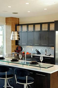 Novum Custom Homes features this sleek and modern kitchen design idea on their profile page over at housetrends.