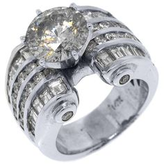 Now THIS is what I'm talking about!!! LMAO    14k White Gold 6.74 Carats Round & Baguette Cut Diamond Engagement Ring