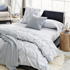 Tried this and absolutely loved it! It was so easy. DIY Pin Tucked Duvet Cover from Living on the Chic