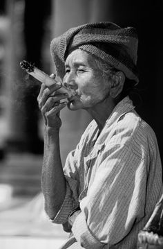 Burmese woman with cheroot, typical burmese cigarre Burma (Myanmar), Asia by Peter Weimann