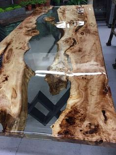 This is a birds eye poplar resin river dinning table with see through clear resin and it even has its own island that looks like its floating in thin air!! This beauty will surely have em talking about the time that they seen your awesome table!!!! This wood comes from sunny