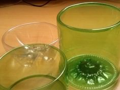 Como fazer acabamento boleado na garrafa pet passo a passo (This video is in a foreign Launage, but shows you how to make the cut edge of a plastic bottle curl to the inside making the top nice and smooth)...