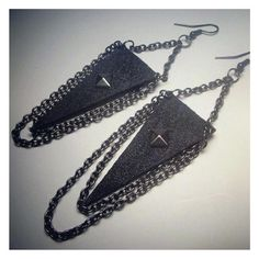 These Denim Triangle Chain Earrings are edgy and punk. 1 inch of gunmetal chain support the reverse denim triangle finished with steel square stud and layers black chains. You will love accessorizing with these earrings. Total Hang length: 4 1/2 in