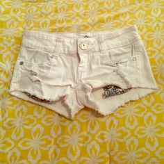 White Denim Shorts  Perfect for Spring! These denim shorts have an adorable pocket embellishment of blue and white pocket lining that shows when you wear the shorts. They do have quite a bit of stretch in them!  Waist is  about 27 inches. Check out the rest of my closet to see the freebies I offer!  Almost Famous Shorts Jean Shorts