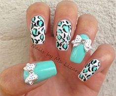 Animal print themed bow nail art. Fill your nails in animal prints and matte color in light blue polish. Top it off with a cute white bow and polka dot embellishment.