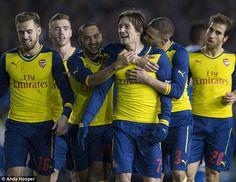 Tomas Rosicky is mobbed by his Arsenal team-mates after scoring what turned out to be the ...