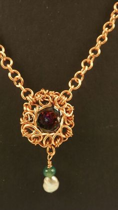 This is a stunning example of what we can do with just copper wire, some beads and a round, large, mystic topaz. This necklace is 22inches long and took a week to make, every link on the chain was handmade, the main stone was hand wrapped, and dropping from the main stone is a silver gray pearl a...
