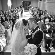 This is one of the best wedding photo angles I have ever seen! I absolutely LOVE this! Eventually some of these people disappear out of your life for many reasons and besides, what better way to show the new joined families than with a beautiful candid shot of the kiss, the joining of the families.