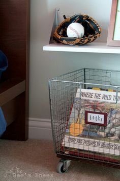 Wire basket on wheels for book storage and floating nightstand with glove & ball