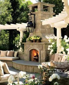 Love the contrast of the white trellis with stone fireplace. Very classy.