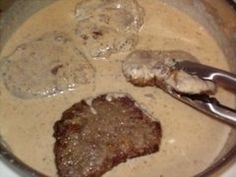 Southern Steak (cheap cut or cube steak) & Milk Gravy - Tender steak smothered in creamy and flavorful milk gravy, this dish is yet another bit of proof that simple food is often times the best! Beef Dishes, Food Dishes, Main Dishes, Chutney, Cube Steak And Gravy, Smothered Cube Steak, Milk Gravy, Southern Recipes, Southern Food