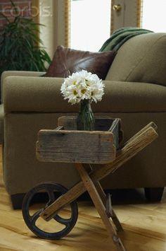 creative...daisies in an old wheelbarrow!