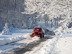 Beautiful restored Willys Jeep plowing snow.