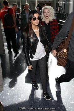 Kourtney Kardashian arrives at LAX airport http://www.icelebz.com/events/kourtney_kardashian_arrives_at_lax_airport/photo1.html