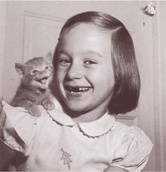 A happy child and a happy cat