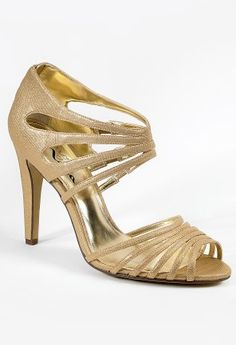 High heel glitter sandal features:• 3.25 heel• Pebble grain texture• Zipperback Closure• Padded insole• Medium width available