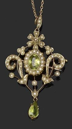 A peridot and seed pearl brooch/pendant of openwork cartouche design, set with a central oval-cut peridot and seed pearl cluster, bordered by scrolling channels of graduated seed pearls, suspending a pear-shaped peridot drop below, stamped '9ct', on a fine trace-link chain, in fitted case