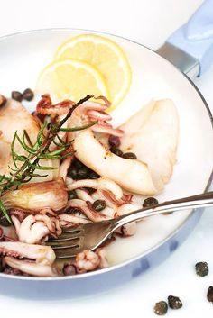 #PRB recipe on EatWell#  GRILLED SQUID WITH SOy SAUCE  Ingredients 2 squids 2 tbsp Pearl River Bridge Superior Light Soy Sauce 2 garlic cloves sliced 1 sprig rosemary 3 tsp capers  lemon Pinch salt  Method Clean squids and put in deep bowl pour in Pearl River Bridge Superior Light Soy Sauce and let marinate for 1 hour.  Heat grill plate. Remove squids from fridge garnish with garlic and rosemary and grill each side for approx. 2 mins.  Serve with capers and squeeze of lemon and salt.