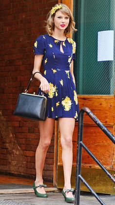 Taylor Swift - blue-and-marigold yellow floral dress, color-matching the sunny hue with a floral headband. As for shoes, she selected green bow-topped Mary