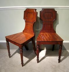 A Pair of Regency Hall Chairs-A fine pair of Regency period solid mahogany hall chairs, with rectangular panelled tablet backs and turned tapering legs. Circa 1820.