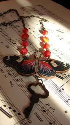 The fall butterfly necklace   antique cuckoo clock chain  vintage glass beads  handmade wooden butterfly  antique jewelry box key
