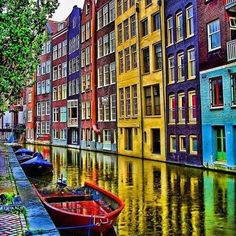 Love the colorful buildings along the river in Amsterdam, Netherlands.