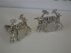 Gifticuffs - A gift shop for musicians and music fans. I love these little drum kit cufflinks!