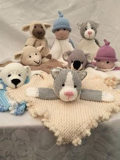 I have designed the mini comfort blankets but customers asked for something in a little bigger so we have the Midi Cuddles. There are 4 blanket options; round or square with frilly edges and round or square with corded edges. Also we have 5 character options; cat; lamb; polar bear; koala and doll. Plus either a collar or straps. So you have plenty of choices to create your own version of Midi Cuddles. These blankets were designed using Aran or Worsted Weight, but can easily be converted to…
