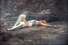 """In this 1967 photo, Actress Jane Fonda, who plays the title role in the space adventure film """"Barbarella,"""" lays on the terrain of the planet Lythium during ..."""