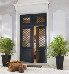 Front door planters are an easy and inexpensive way to spruce up your front entrance. Here are 70 ways to incorporate planters into your home's design! House Doors, House Entrance, Entrance Doors, Door Entry, Interior Exterior, Exterior Doors, Door Design, House Design, Front Door Planters
