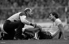 Trevor Francis of England (right) receiving treatment for an injury from physiotherapist Fred Street during the British Home Championship match between England and Scotland at Wembley Stadium in London, 23rd May 1981. Scotland won 1-0.