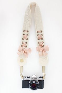 Who says camera straps have to be dull, boring and especially manly? Need this to add a little whimsy at my weddings!