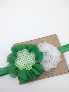 Luck of the Irish Headband! A green headband with a green ballerina flower centered with an adorable felt shamrock with a white shabby flower. The