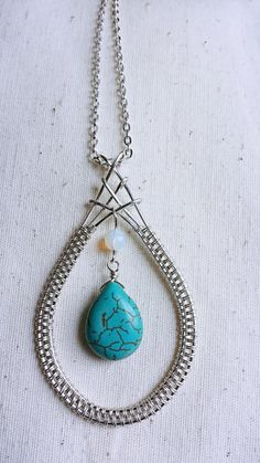 Gorgeous original large handmade silver filled wire woven pendant with a lovely turquoise howlite briolette feature teardrop topped with a faceted opalite bead. The earrings are turquoise howlite briolettes wrapped in silver filled on french silver earwires.  This is a large pendant & would suit any occasion, from everyday wear to paired with that special outfit. It can also be made with copper wire, as can the earrings, just send me a message for a custom piece.  It has a large bail, so ...