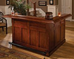 This cherry L-shaped home bar is fairly large for a bar cabinet you can buy online.