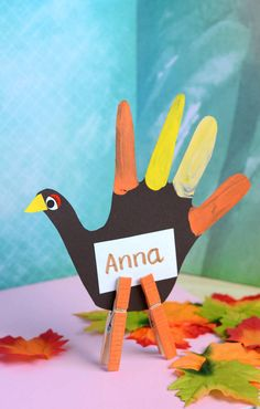 Found it at Blitsy - DIY Handprint Turkey Place Card Holder